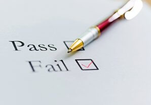 Pass and Fail list with a pen.